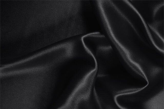 Tessuto Crêpe Satin Nero in seta per abbigliamento