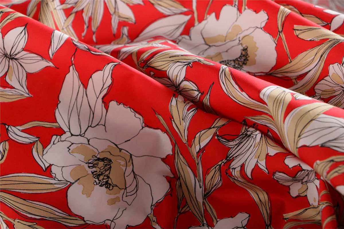 White and beige floral cotton canvas fabric printed with white and beige floral design on a red base | new tess