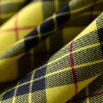 Tartan fabric in pure wool in shades of yellow and black | new tess
