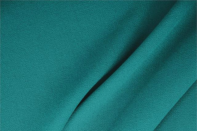 Buy online our clothing and fashion fabric 'Turchese' Blue  Wool Double Crêpe, Made in Italy. - new tess