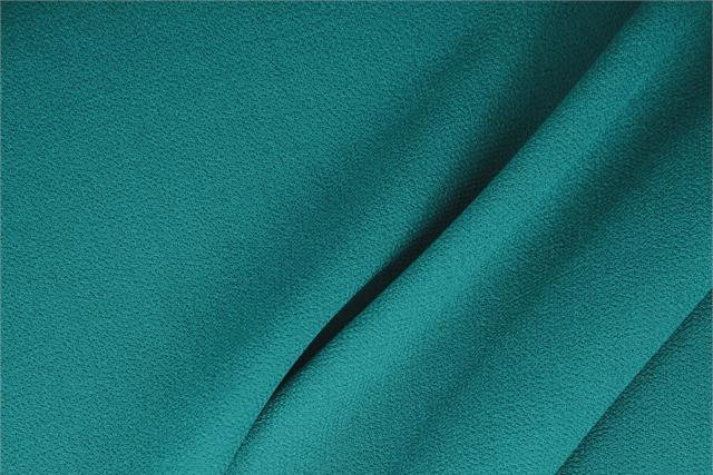 Acquista online il nostro tessuto per abbigliamento, sartoria e moda Doppia Crepella di Lana Blu 'Turchese', Made in Italy. - new tess