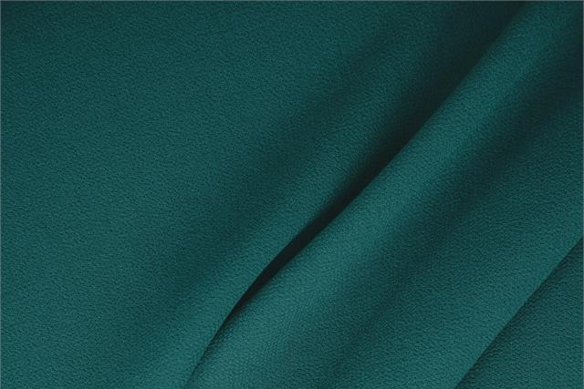 Buy online our clothing and fashion fabric 'Pavone' Blue  Wool Double Crêpe, Made in Italy. - new tess