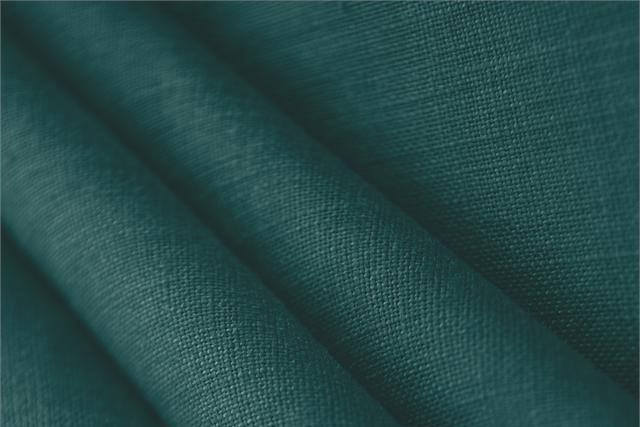 Buy online our clothing and fashion fabric 'Petrolio' Blue  Linen Canvas, Made in Italy. - new tess