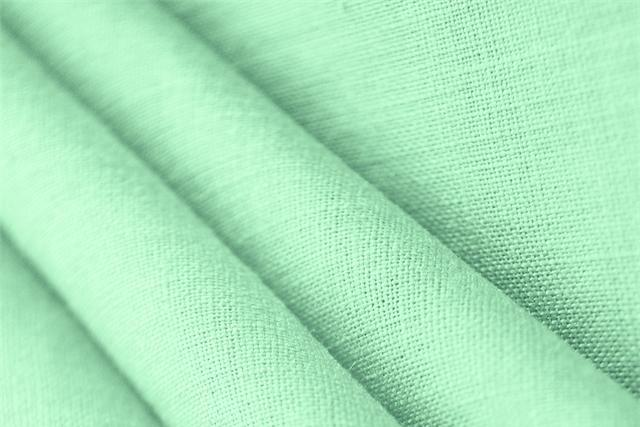 Buy online our clothing and fashion fabric 'Acqua Marina' Green  Linen Canvas, Made in Italy. - new tess