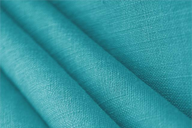 Buy online our clothing and fashion fabric 'Turchese' Blue  Linen Canvas, Made in Italy. - new tess