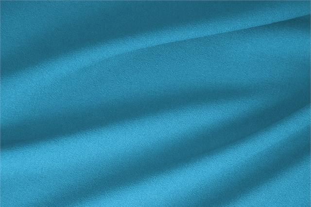 Buy online our clothing and fashion fabric 'Turchese' Blue  Wool Stretch, Made in Italy. - new tess