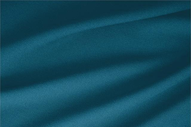 Buy online our clothing and fashion fabric 'Pavone' Blue  Wool Stretch, Made in Italy. - new tess