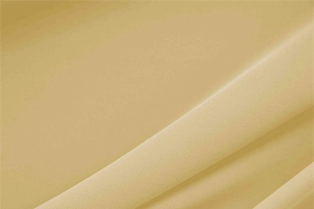 Buy online our clothing and fashion fabric 'Duna' Beige Polyester Heavy Microfiber, Made in Italy. - new tess