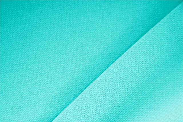 Acquista online il nostro tessuto per abbigliamento, sartoria e moda Microfibra Crepe Pavone. - new tess