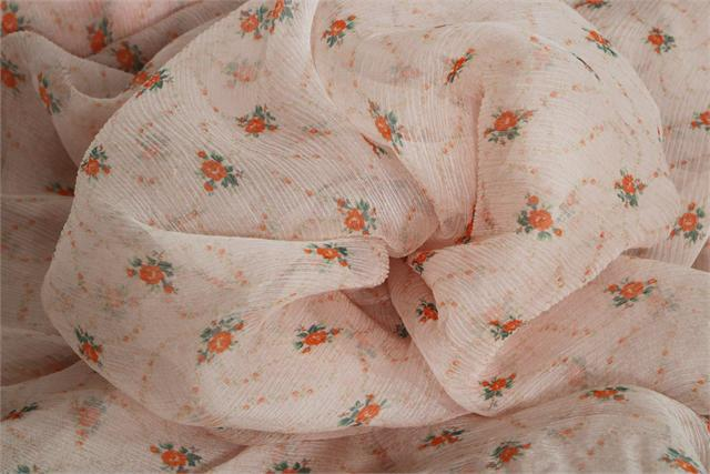 Orange and pink silk crepon fabric with floral pattern