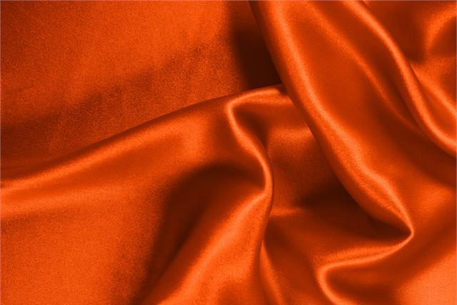 Buy online our clothing and fashion fabric 'Corallo' Orange Silk Crêpe Satin, Made in Italy. - new tess