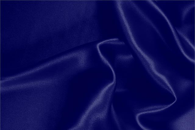 Buy online our clothing and fashion fabric 'Persia' Blue Silk Crêpe Satin, Made in Italy. - new tess