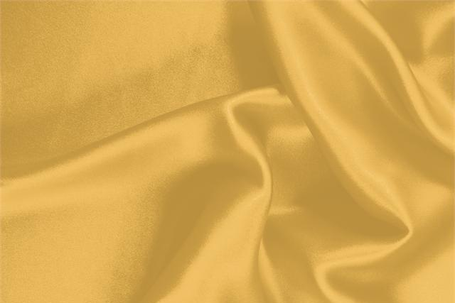 Buy online our clothing and fashion fabric 'Tuorlo' Orange Silk Crêpe Satin, Made in Italy. - new tess
