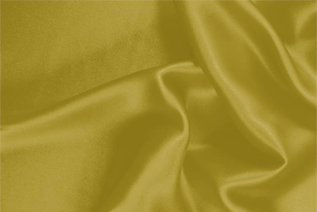 Buy online our clothing and fashion fabric 'Olio' Yellow Silk Crêpe Satin, Made in Italy. - new tess