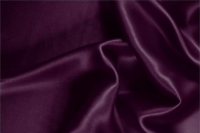 Buy online our clothing and fashion fabric 'Prugna' Purple Silk Crêpe Satin, Made in Italy. - new tess