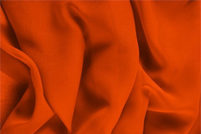 Buy online our clothing and fashion fabric 'Corallo' Orange Silk Georgette, Made in Italy. - new tess