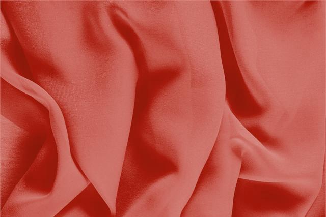 Acquista online il nostro tessuto per abbigliamento, sartoria e moda Georgette Arancione Pomodoro, Made in Italy. - new tess