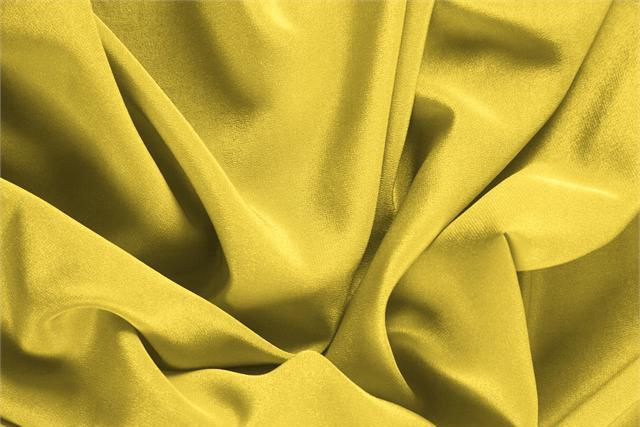 Buy online our clothing and fashion fabric 'Primula' Yellow Silk Crêpe de Chine, Made in Italy. - new tess