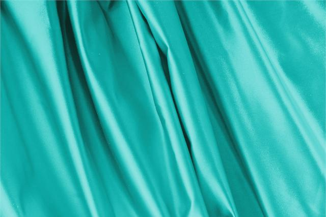 Buy online our clothing and fashion fabric 'Pavone' Blue Silk Duchesse, Made in Italy. - new tess