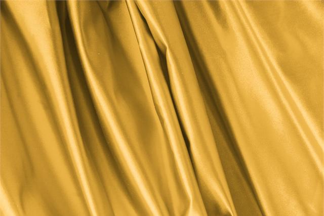 Buy online our clothing and fashion fabric 'Arancio' Yellow Silk Duchesse, Made in Italy. - new tess