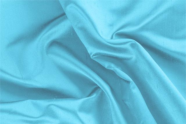 Buy online our clothing and fashion fabric 'Antille' Blue Silk Shantung Satin, Made in Italy. - new tess